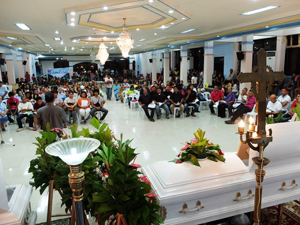 Usually a venue for festive events, the province's Social Hall kept the remains of three massacre victims for almost a week.  It would later also host a four-year-old evacuee who would die mere hours after this tribute concluded.