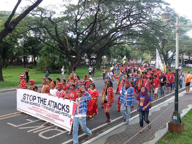 Manilakbayan participants march from their campsite to the academic oval to meet supporters.
