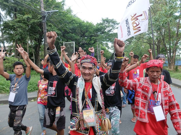 An elderly 'Manilakbayani' with his raised clenched fists at the start of the  Unity Walk.