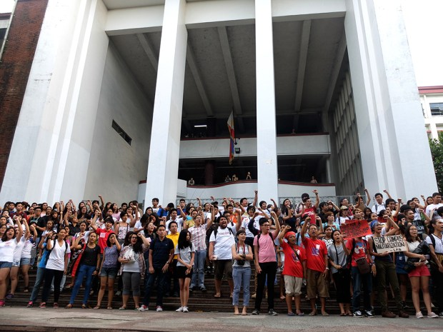 UP students saluting the Lumad with clenched fists at the steps of Palma Hall.