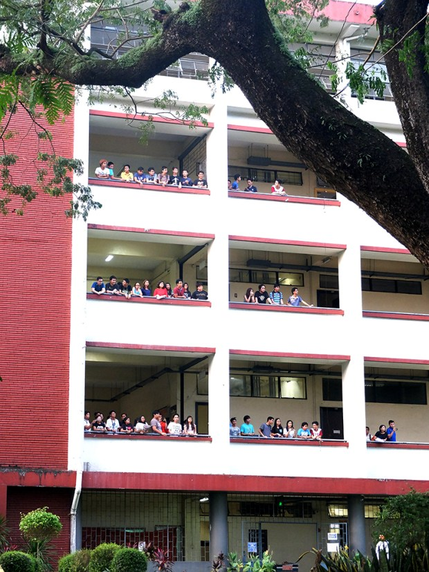 College of Engineering students watching the unity walk from the Melchor Hall.