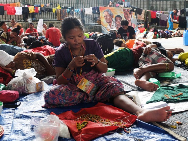 Pedela Pandagit, 24 years old and Datu Jimbo'y wife, leads her group in creating bead ornaments.
