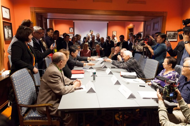 GRP and NDFP panelists exchange copies of partial agreements on Day 4 of their negotiations.
