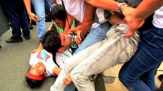Katribu leader and Sandugo convenor Pia Macliing Malayao lies on the ground after being hit by the police vehicle.