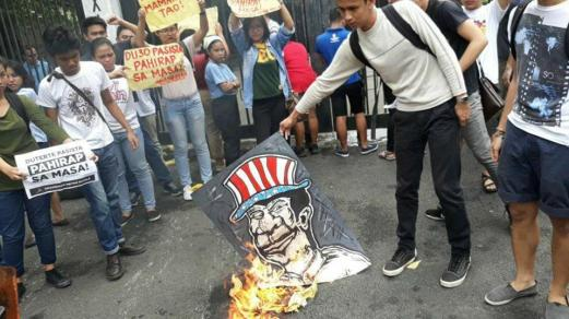 Anakbayan Metro Manila burns an image of Duterte following the President's cuss-filled tirade against striking jeepney drivers. (Photo by Kathy Yamzon)