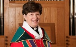 Bishop Eaton in church with colorful robe