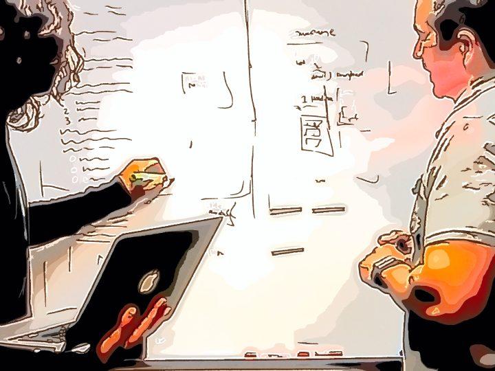 Workshop-Teilnehmer erarbeiten eine Fragestellung. Agile Methoden, Design Thinking