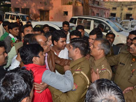 SP leader by knocking the soldiers down, beaten