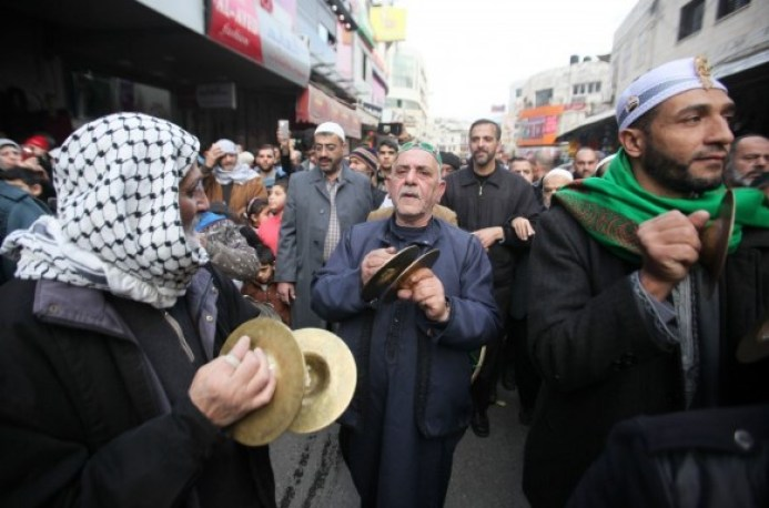 Men sing devotional songs in praise of the life and personality of Prophet Muhammad in the streets of Nablus, Palestine. (Getty Images)