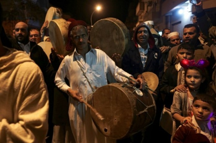 Sufi Muslims chant and beat drums during a procession celebrating the religious holiday of Mawlid, the birthday of Prophet Muhammad, in Benghazi, Libya. (Reuters)