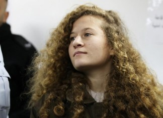 palestinian teen ahed tamimi enters a military courtroom at ofer prison, near the west bank city of ramallah
