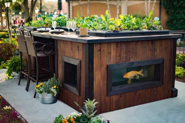 patio dining center with small koi pond