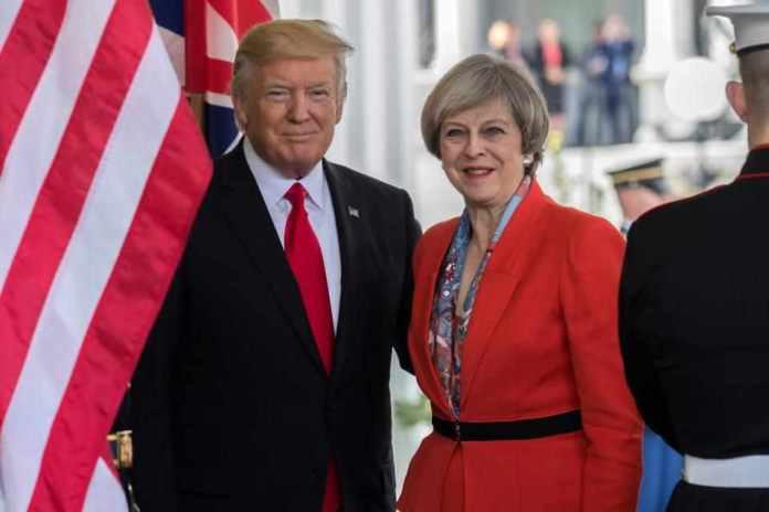 Theresa may fires Donald Trump