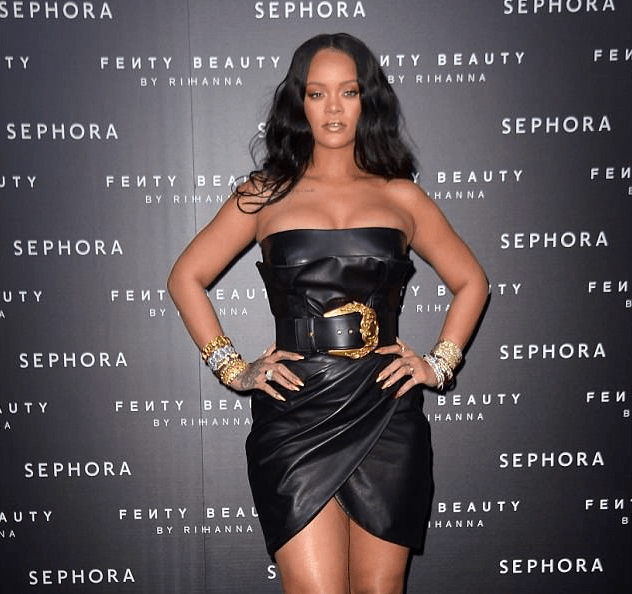 Style Stalking: Rihanna Wows In Cleavage-Baring leather Dress For Fenty Beauty Launch In Italy 1