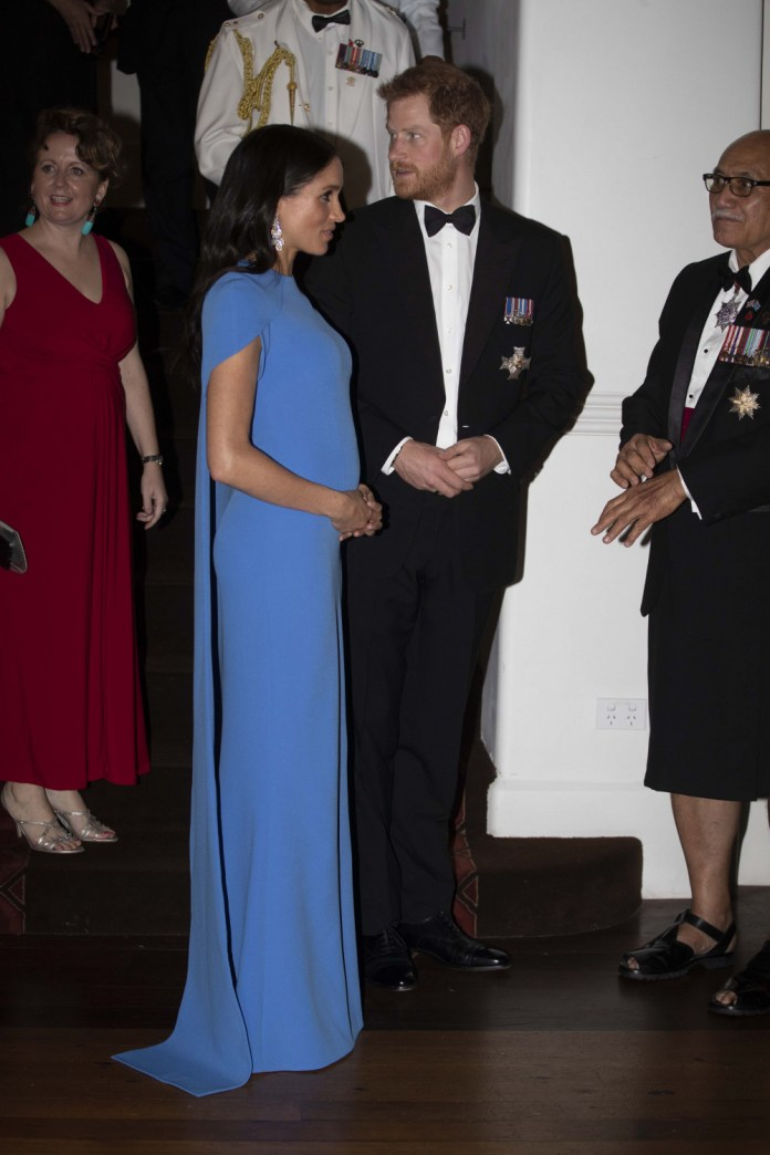 Who What Wear: Meghan Markle Flaunts Her Growing Baby Bump In Cape-sleeved Sefiya Gown 1