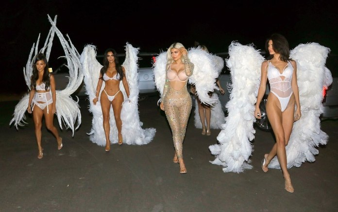Kardashians/Jenner Sister Show Off Their Incredible Figures In Barely There Halloween Costumes 2