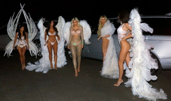 Kardashians/Jenner Sister Show Off Their Incredible Figures In Barely There Halloween Costumes 6