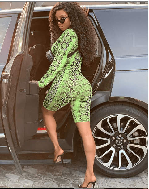 Style Stalking: Toke Makinwa Looks Gorgeous In A Snakeskin Catsuit And Gucci Pouch 2