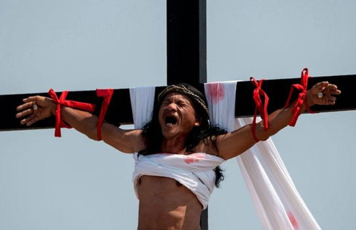Jesus Wept! Good Friday Tradition Sees Screaming Christians Nailed To Crucifixes 2