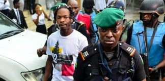 Naira Marley and A Nigerian Police Official