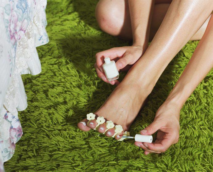 applying nail polish KOKO TV NG