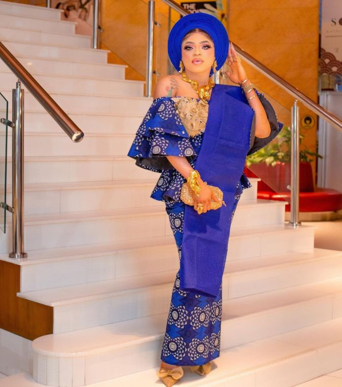 Bobrisky Sprays Bundles Of Naira Notes On Tiwa Savage At Her Father's Burial