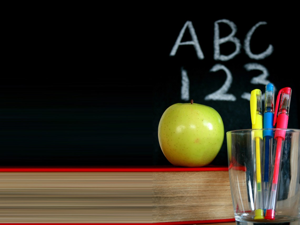 Chalkboard with a green apple and pens backgrounds Free Apple Wallpapers For Iphone