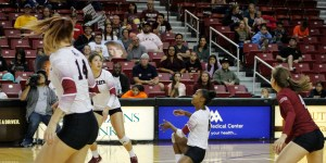 NMSU women's volleyball players battle it out against the Seattle University Redhawks Saturday at the Pan American Center during their last home match of the season. The Aggies went on to win the match in three straight sets, extending their home winning streak to 13. The team improved to 19-7 (10-2) on the season and remain in sole possession of first place in the WAC standings. (Photo by Sienna Mata/Kokopelli)