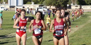 Aggie junior Julia Yescas, left, and sophomore Jess Dominguez compete in the Lori Fitzgerald Invitational on Saturday, Sept. 15, at the NMSU Track and Intramural Fields. (Photo by Victoria Balderrama/Kokopelli)