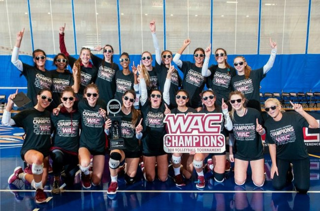 The NMSU women's volleyball team celebrates its fourth WAC championship victory in seven years Saturdy, Nov. 24, 2018, in Bakersfield, California. (Photo courtesy of NMSU athletics)