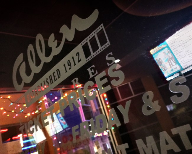 The Allen Theatres ticket window at Cineport 10 in Las Cruces is adorned with holiday lights. Several major studio releases are timed to coincide with this year's nationwide holiday box office surge. (Photo by Kokopelli Staff)