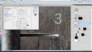『突起外形』<写真5-2>に「ベベルとエンボス」のレイヤースタイルを設定する。