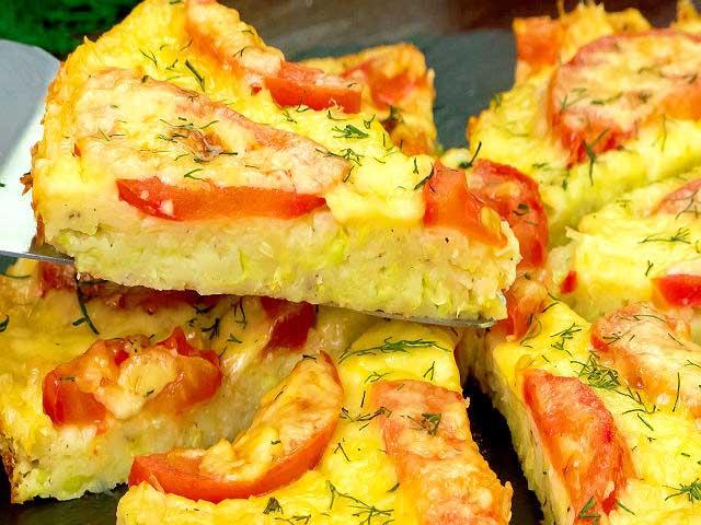 Піца з кабачків з шинкою і овочами