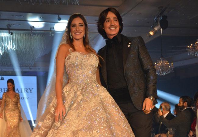 امينة خليل تتألق بفستان العروس في دفيليه البحيري لشتاء 2017 - بارزة