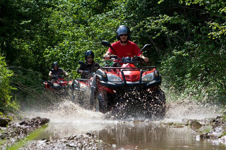 Quad ride through the woods, water, dirt road