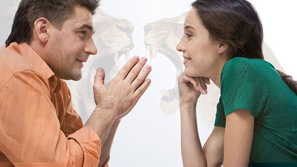 Happy couple having conversation face to face and looking at each other