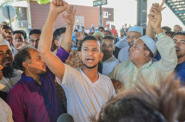 Khairul Islam Kukon, 33, and other members of the Al-Furqan mosque, protest against Donald Trump after the slaying of imam Akonjee in Ozone Park, Queens