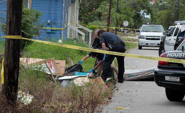Police search for clues at crime scene1