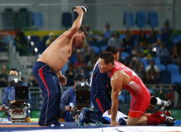 The coaches of Mandakhnaran Ganzorig stripped down to their skinnies in protest2.jpg