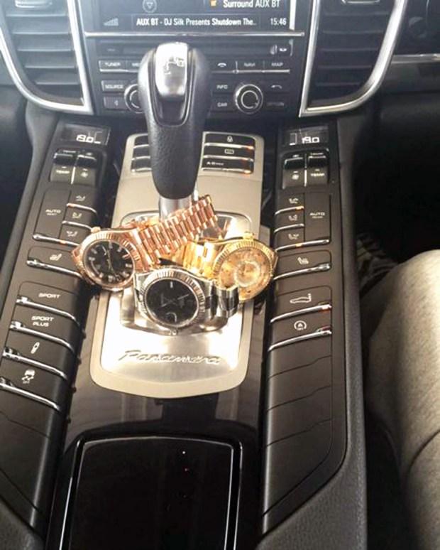 Levi Watson three watches wrapped around a Porsche gear shift.jpg