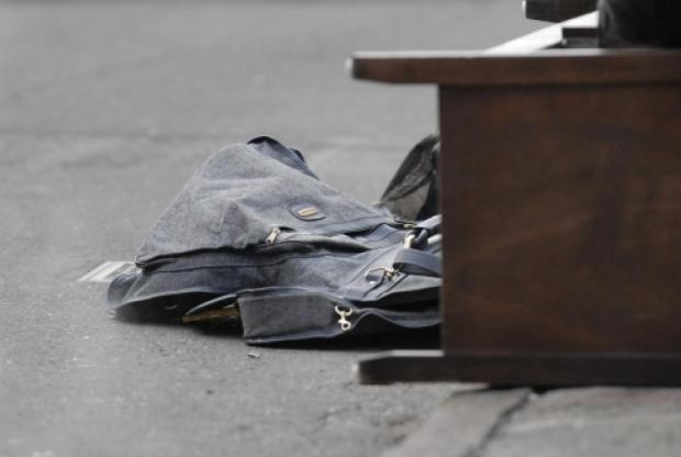 A witness told cops that the suspect fled into the pre-dawn darkness in a silver SUV after tossing the remains into a pile of garbage bags.jpg