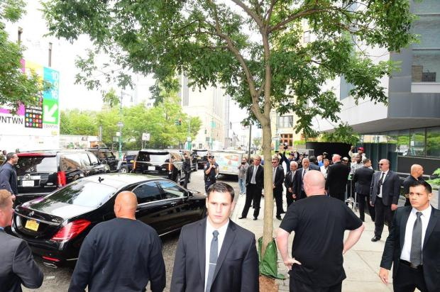 Large security team led Kardashian from the airport to her apartment.jpg