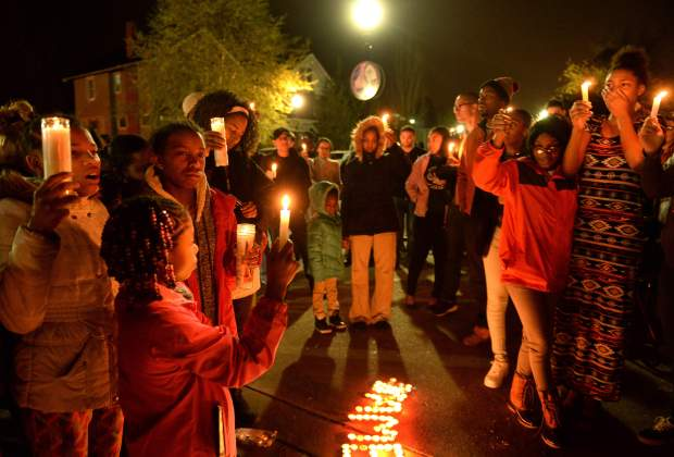 Classmates, friends and family members gathered Wednesday evening on Charleston's East End to hold a candlelight vigil for 15-year-old James Means, who was shot and killed Monday evening..jpg
