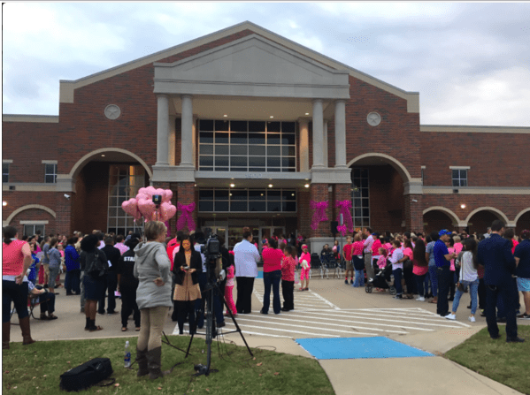 Mourners at vigil held for Kayla.png