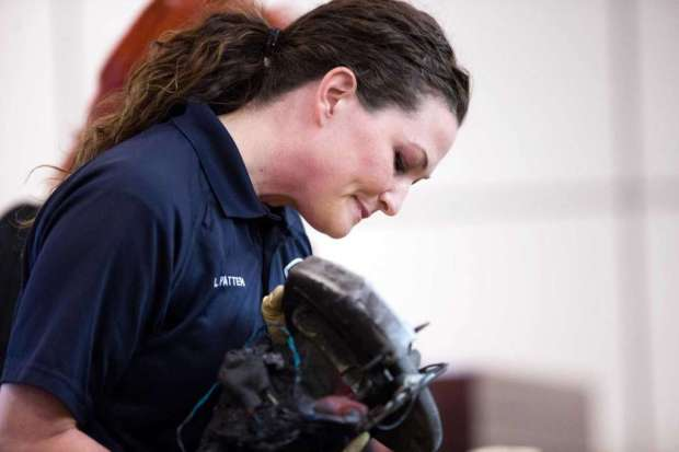investigator-lyndsey-patten-examines-charred-saw-submitted-as-evidence-in-michael-scott-quinn-trial