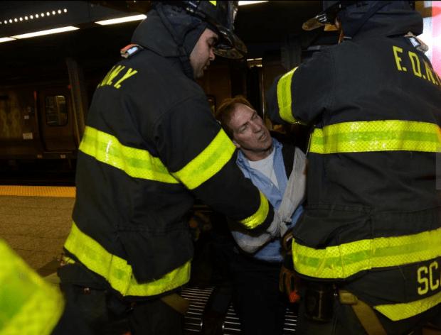 Injured passenger being removed by EMT3.png