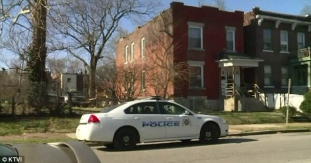 A St. Louis Police car is seen outside of Thompson's home in St. Louis on Friday.jpg