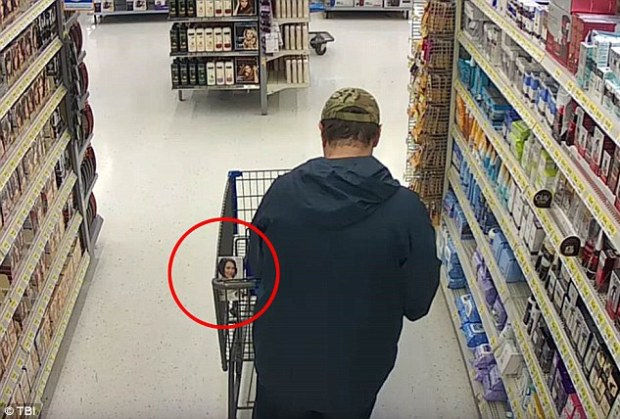 Cummins buying dark hair dye from a Walmart in Columbia, Tennessee, the day before he vanished with the student.jpg