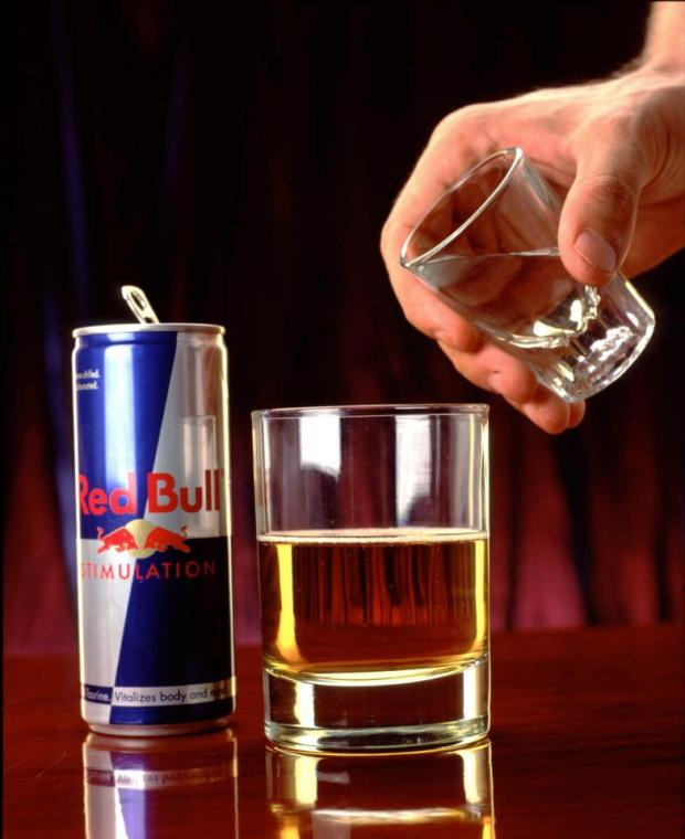 Energy drinks like Red Bull mask the effects of tiredness and can lead to injury, research suggests.jpg