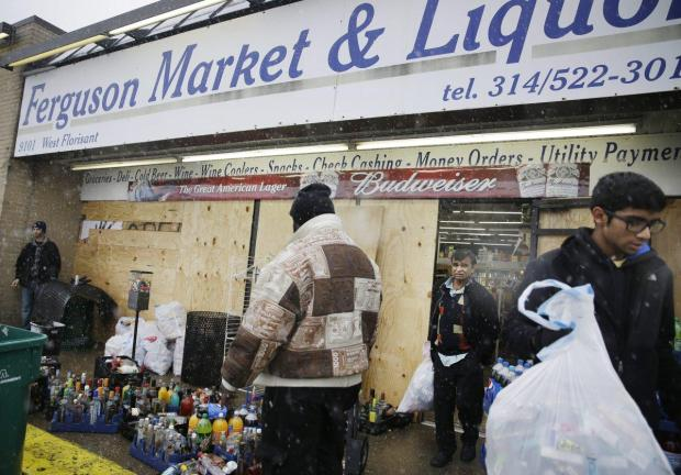 Protesters have flocked to the Ferguson Market where Michael Brown visited before being shot to death in 2014.jpg